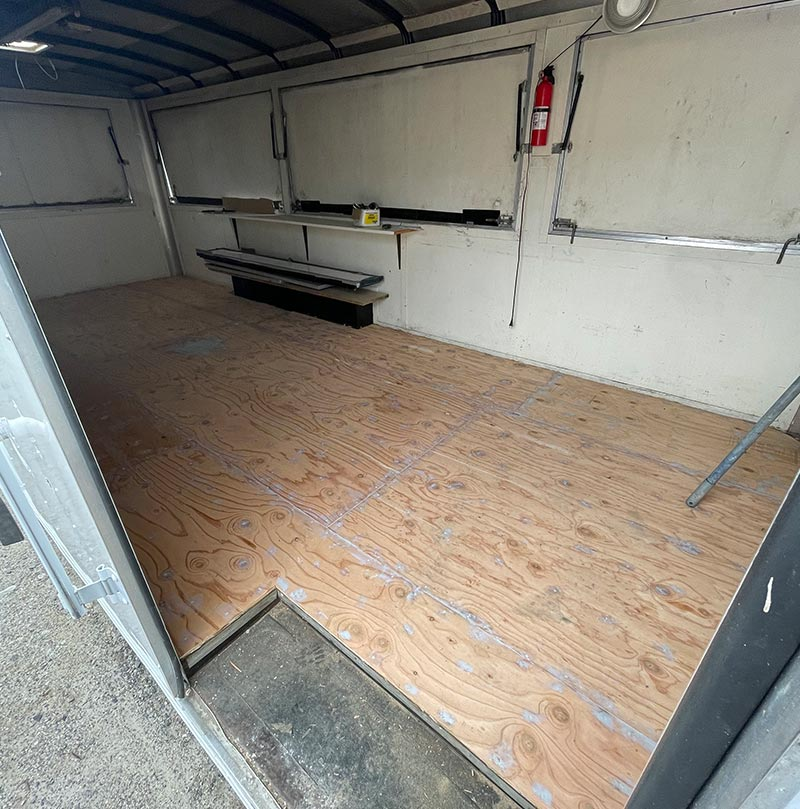 Before Installation of epoxy floor in food truck Side View