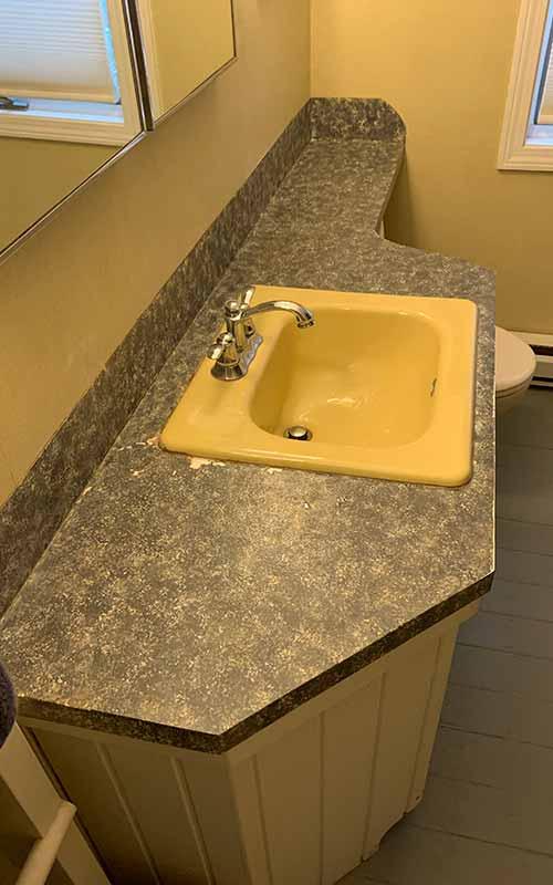 Before epoxy covering in bathroom countertop