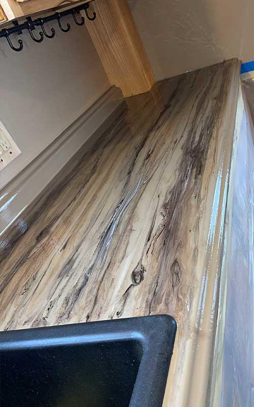 Wood design on epoxy countertop in kitchen